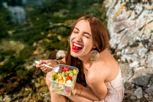 woman eating healthy happy