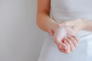 soft focus on hand of woman feel pain that are sign of Rheumatoid Arthritis or  Osteoarthritis of bone problem