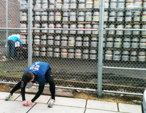 Runner Stretching in front of kegs