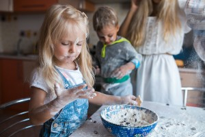 mother children playing flour